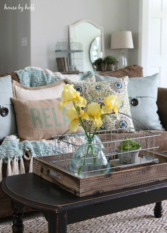 light blue and brown living room with yellow flowers