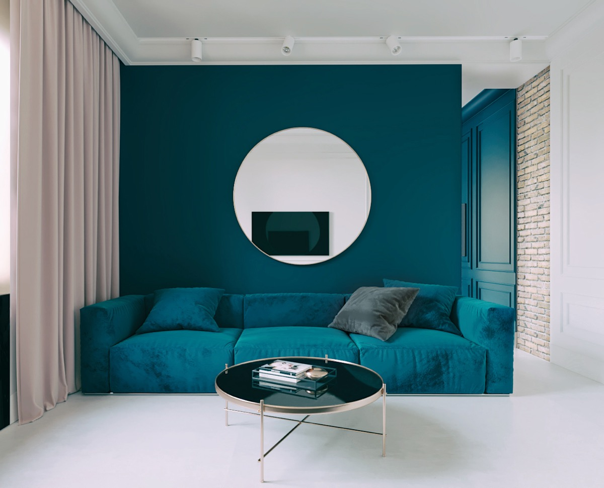 Beautiful Blue Living Rooms Teal Accent Wall And Teal Couch WIth Round Mirror And Round Gold Table - 53 Cool Living Rooms With Irresistible Modern Appeal