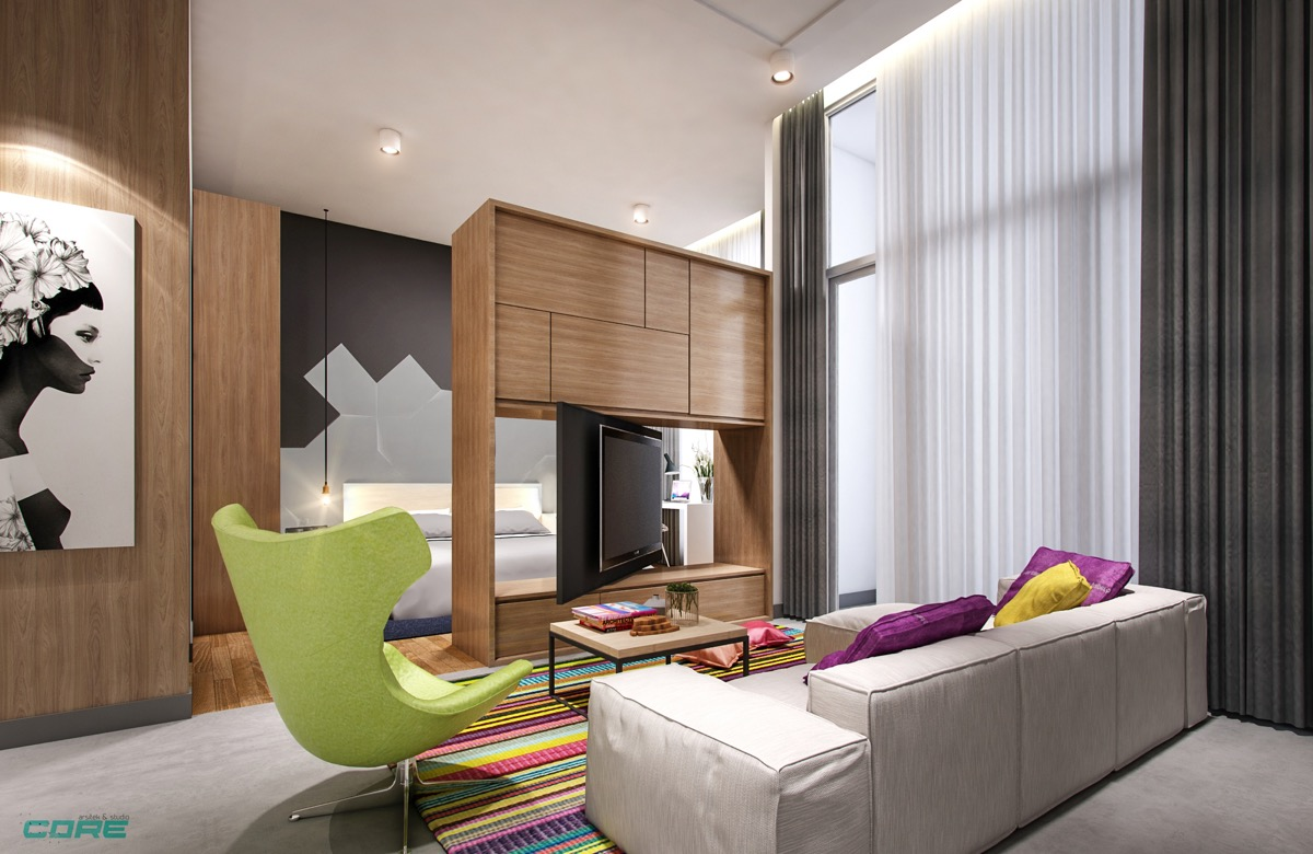 Beautiful Living Room In Bachelor Apartment With Swivel TV And Colorful Living Room - 53 Cool Living Rooms With Irresistible Modern Appeal