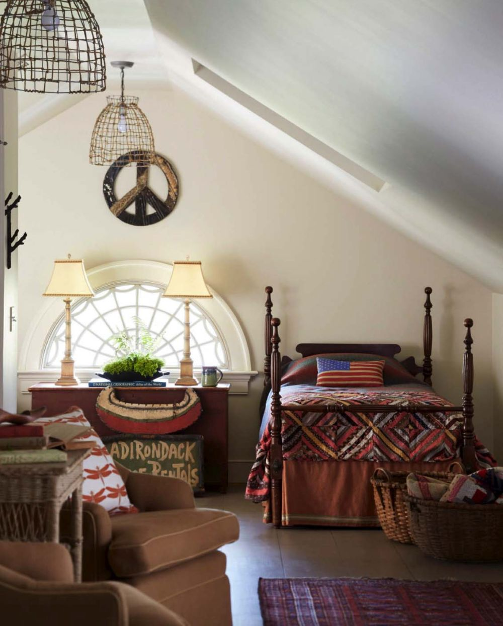 The upstairs bedrooms looks very cozy thanks to the small semi circular window and the pitched roof