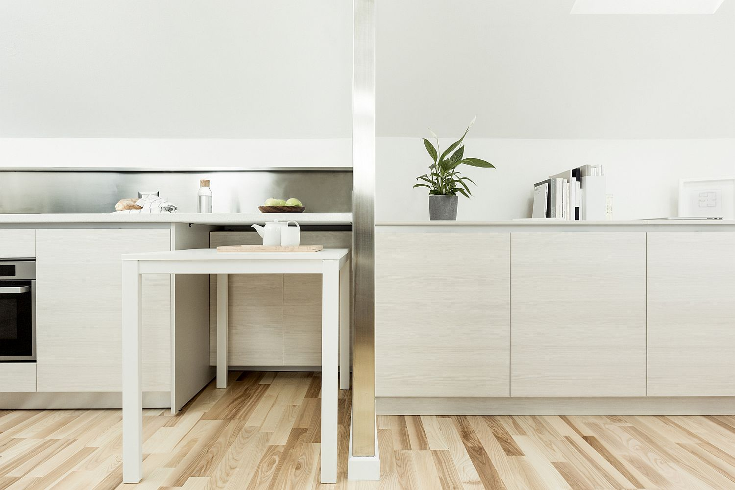 1559229132 880 compact white and wood apartment in milan maximizes space in style - Compact White and Wood Apartment in Milan Maximizes Space in Style