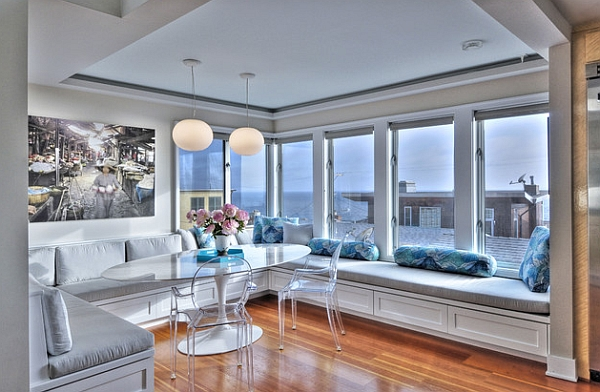 Beautiful modern dining area with Eero Saarinen Oval Tulip Table