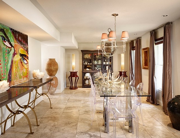 Starck Louis Ghost Chairs in clear look even more elegant when coupled with glass tables