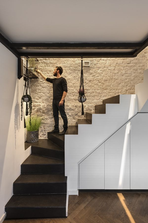 The staircase is framed by a beautiful textured wall on one side, a very cool design details