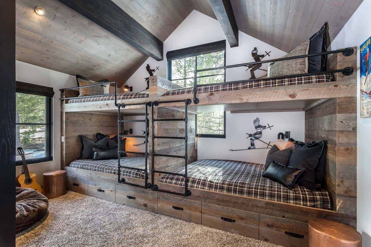 One of the bedrooms has custom-built bunk beds with plenty of storage inside the drawers