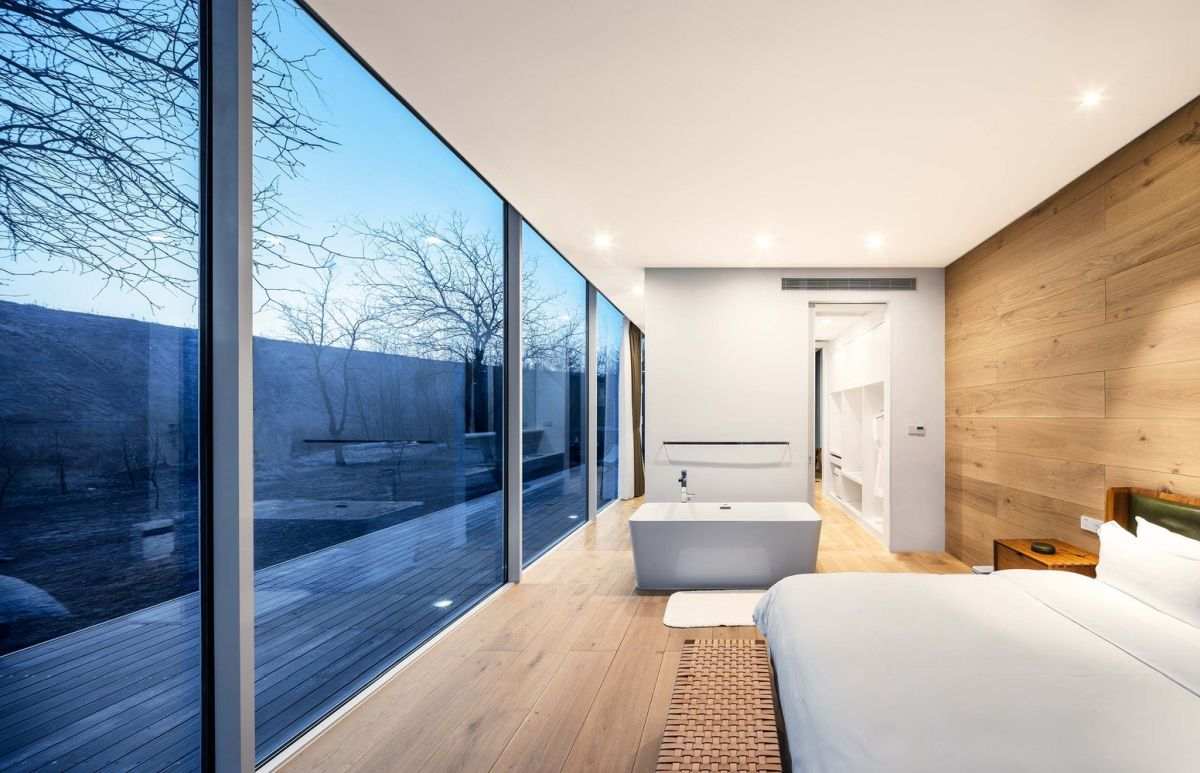 The wooden deck links the indoor and outdoor, making the transition more seamless