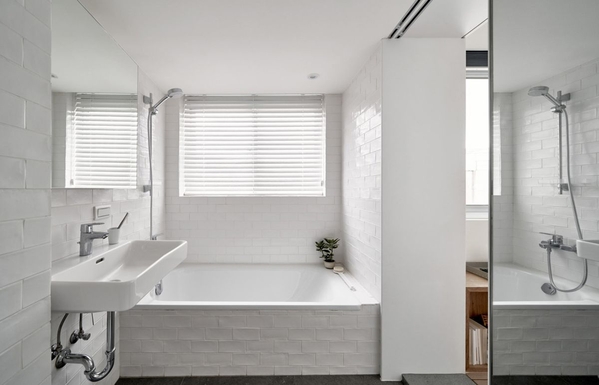 The bathroom now has more sunlight than before and a mirror door which helps it appear larger