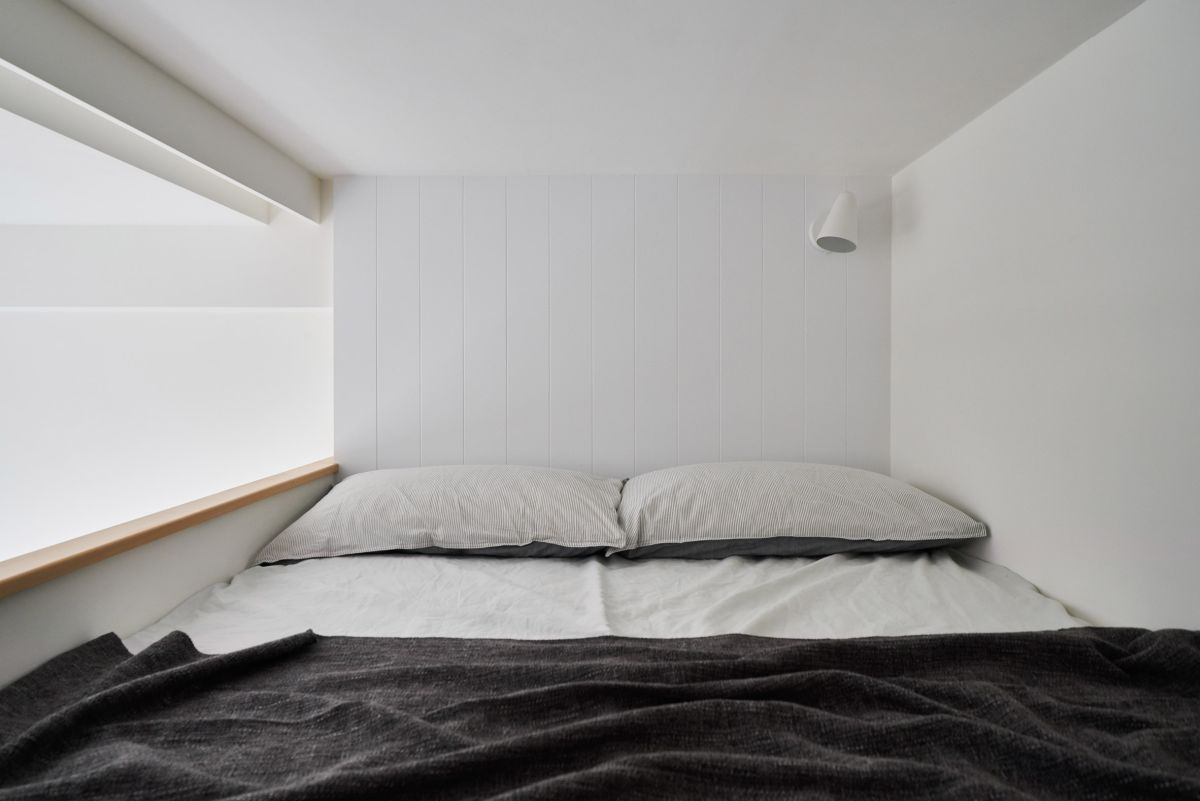 The mezzanine floor is super minimalist, with nothing more than a mattress and a wall-mounted sconce