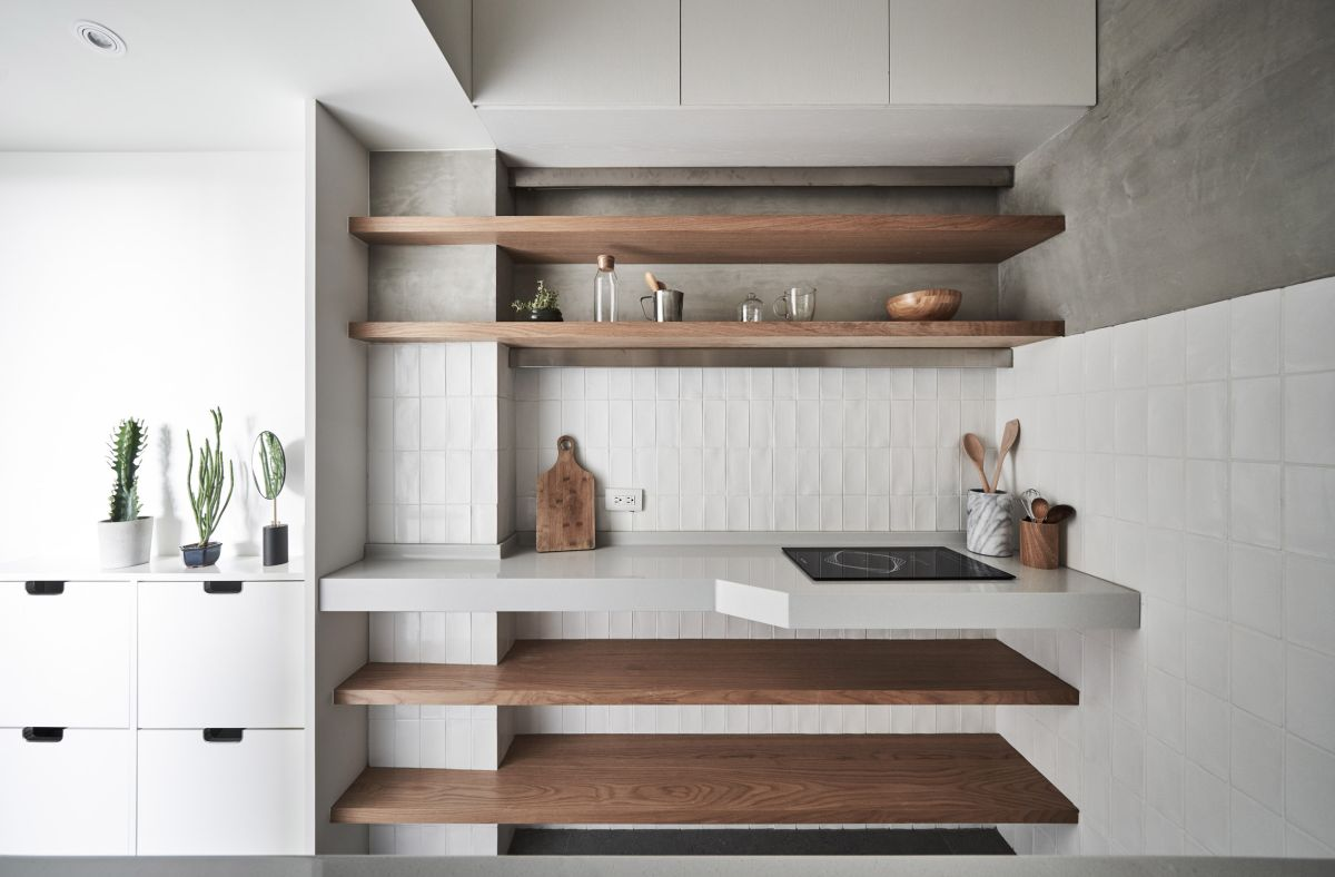 The kitchen seamlessly transitions into the entryway but at the same time maintains its independence