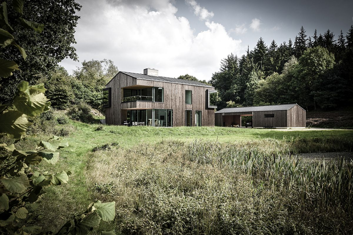 The timber-clad exterior helps the house blend into the landscape seamlessly