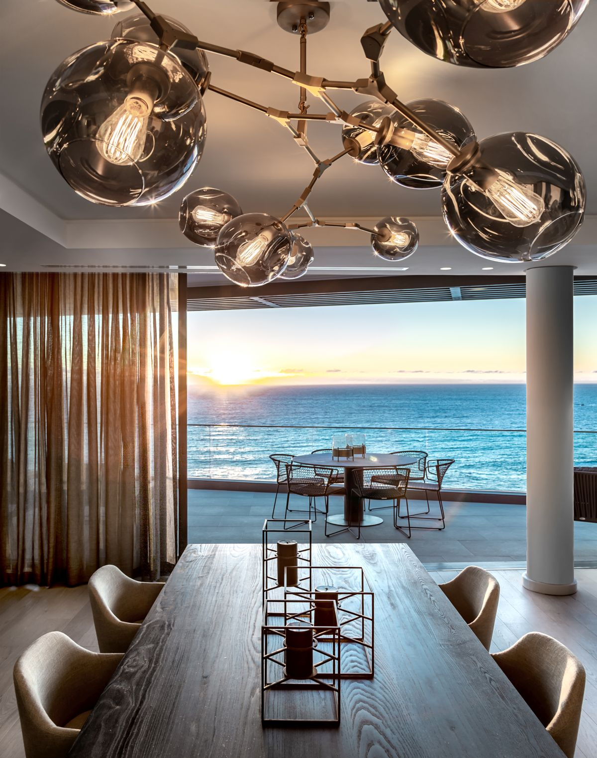 The terrace overlooks the Atlantic Ocean, offering panoramic views and letting in lots of sunlight