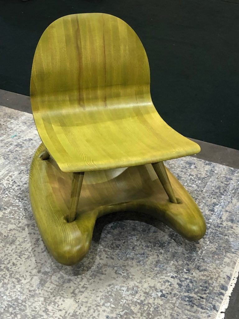 The unexpected color and organic shape of the base make this rocker distinctive.