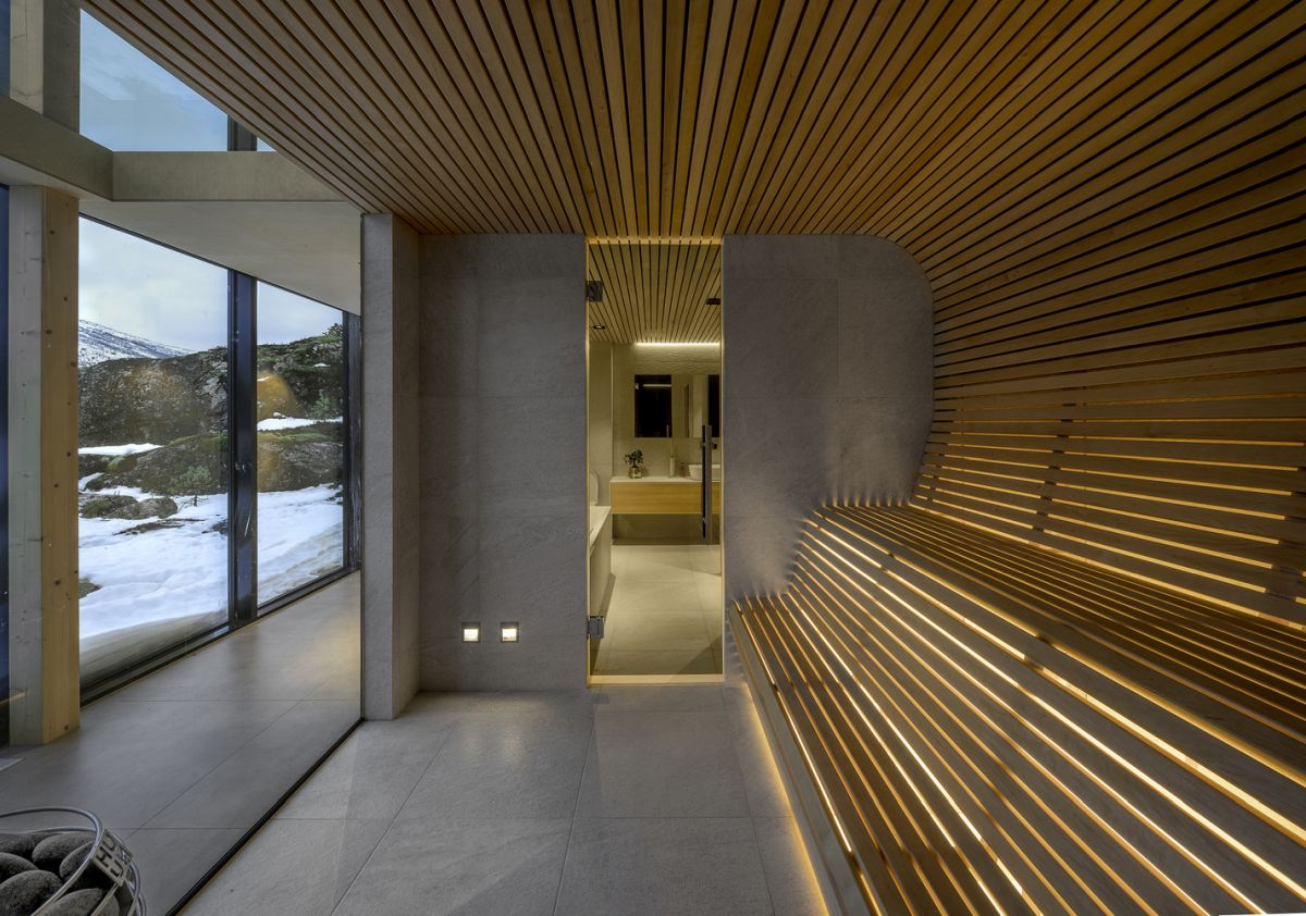 The cain has a sauna which features a combination of concrete and aspen wood, a look that extends to the bathroom