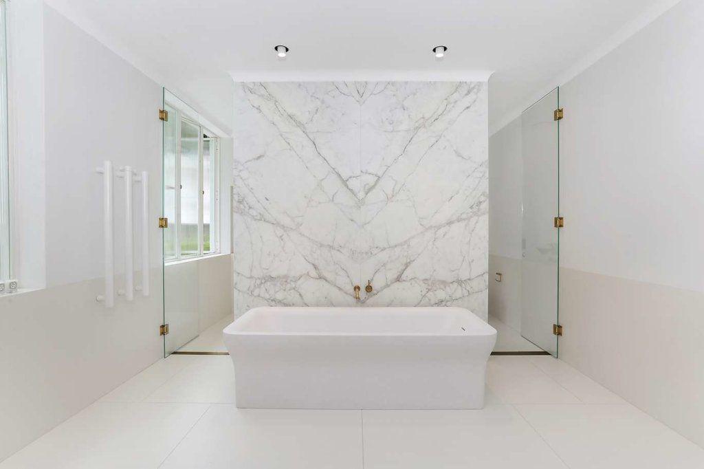 1563970414 380 25 white bathroom design ideas that are effortlessly beautiful - 25 White Bathroom Design Ideas That Are Effortlessly Beautiful