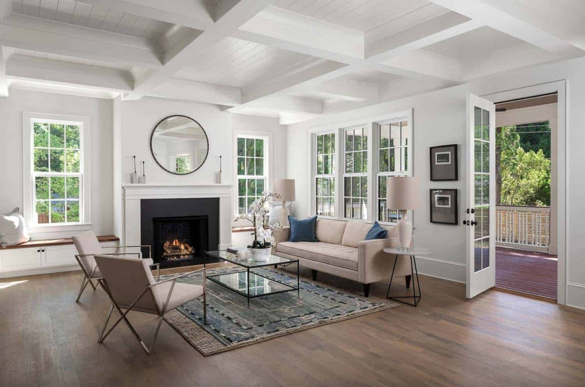 The living room is bright and spacious and has a fireplace that gives it a warm and cozy feel
