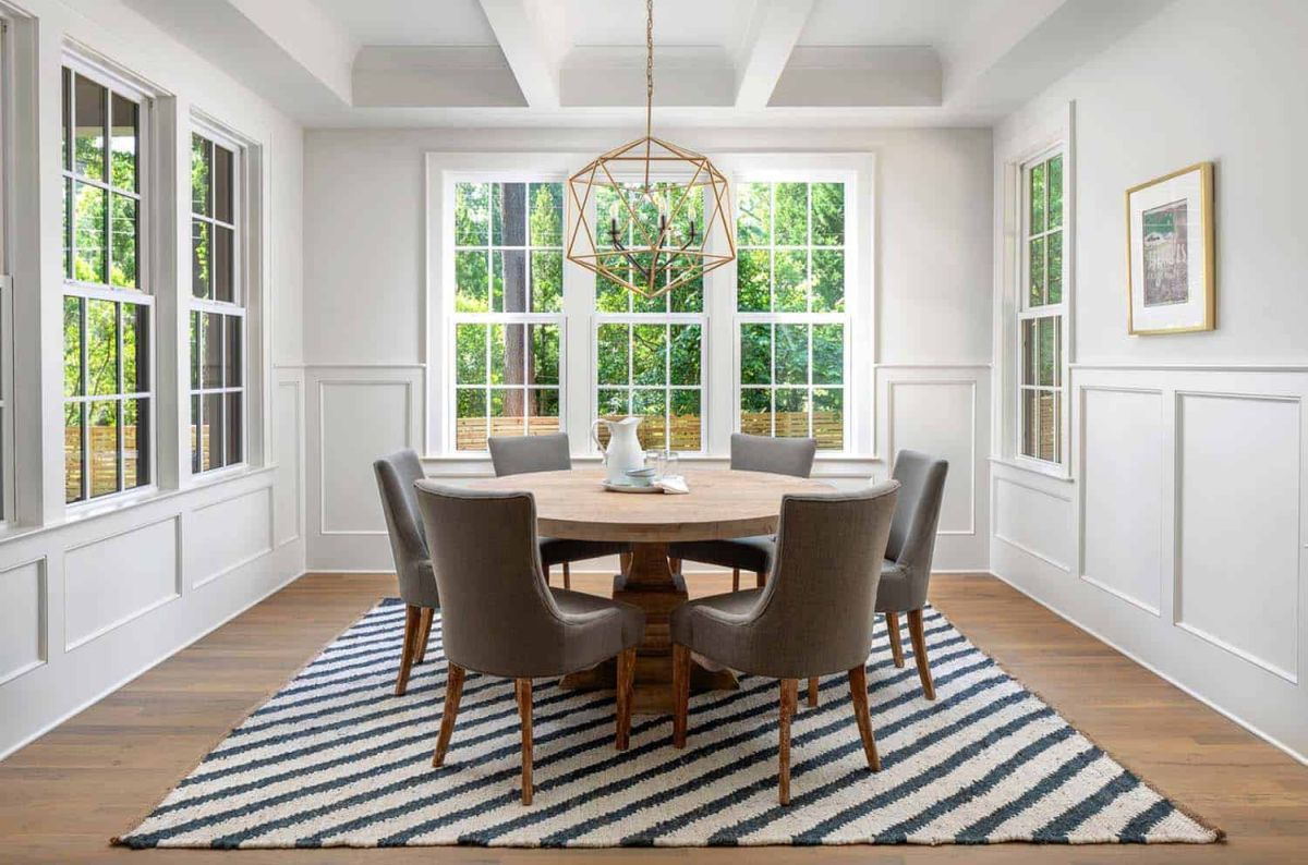 The dining area is wonderful, featuring a round table and large windows
