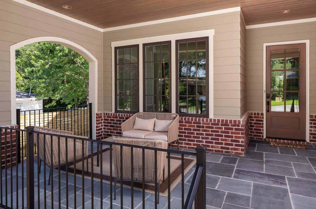 There's a small covered porch at the front, with bluestone flooring and comfy seats