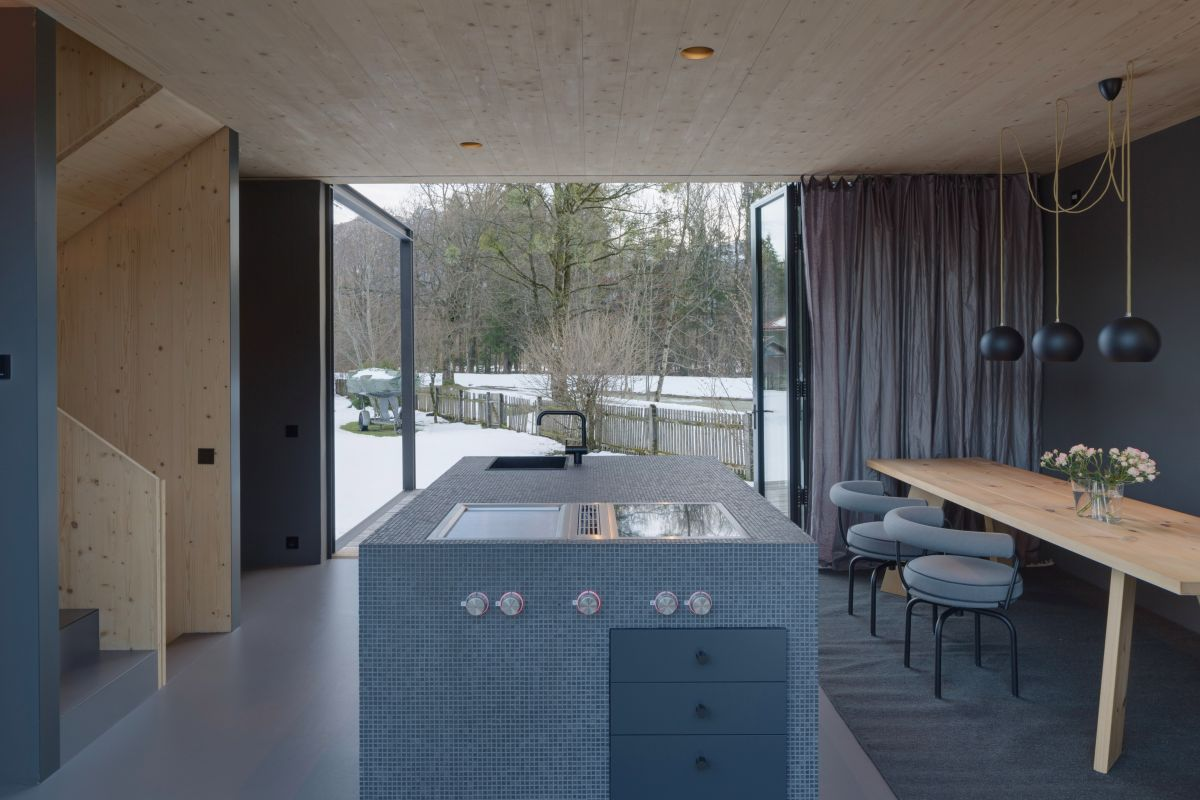 The large glass doors let in lots of sunlight and also frame a great view of the garden
