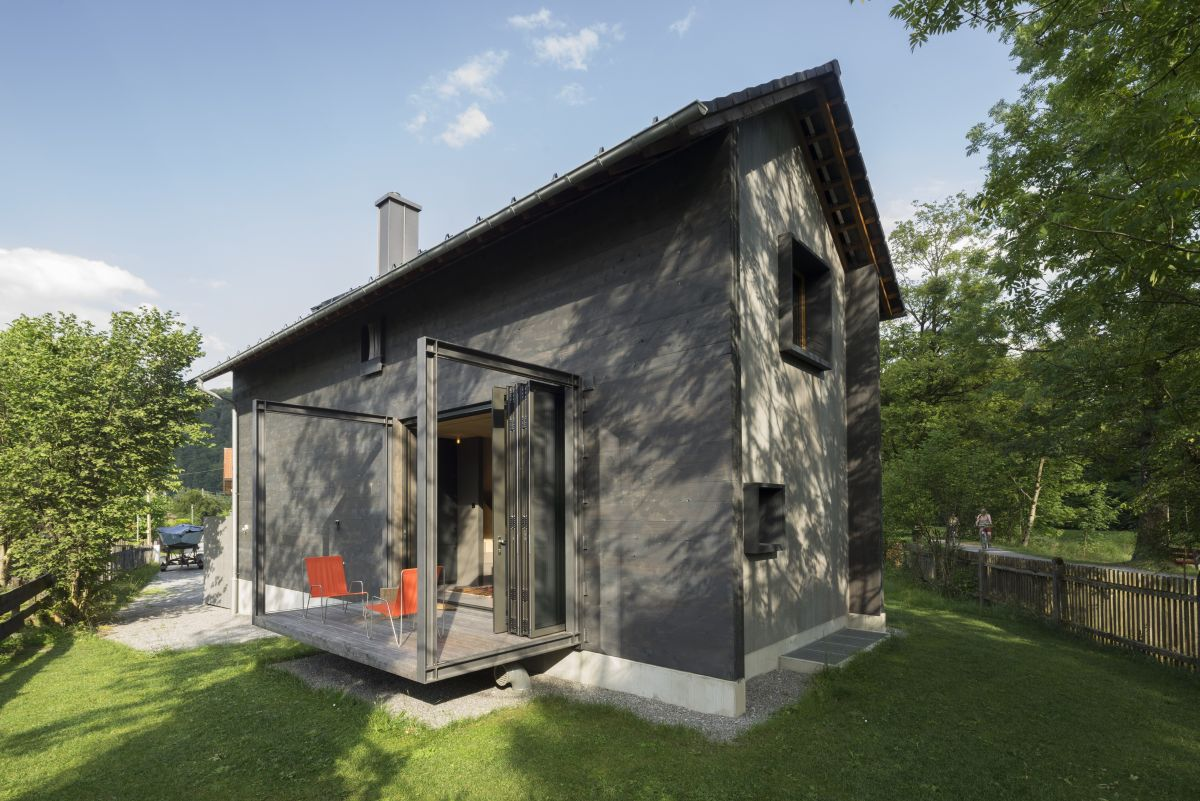 The overall design and architecture of the house are modern with influences from rustic cabins