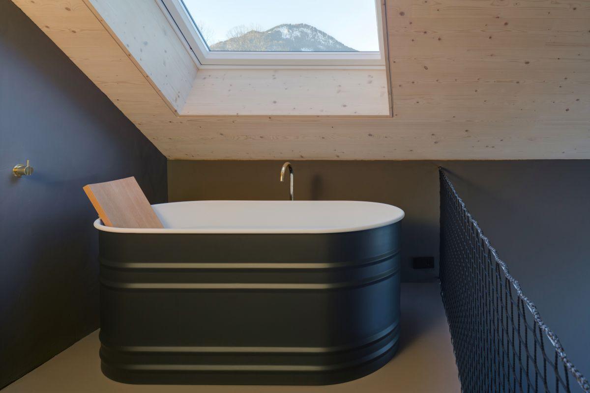 Upstairs, the sleeping has an en-suite bathroom with a skylight