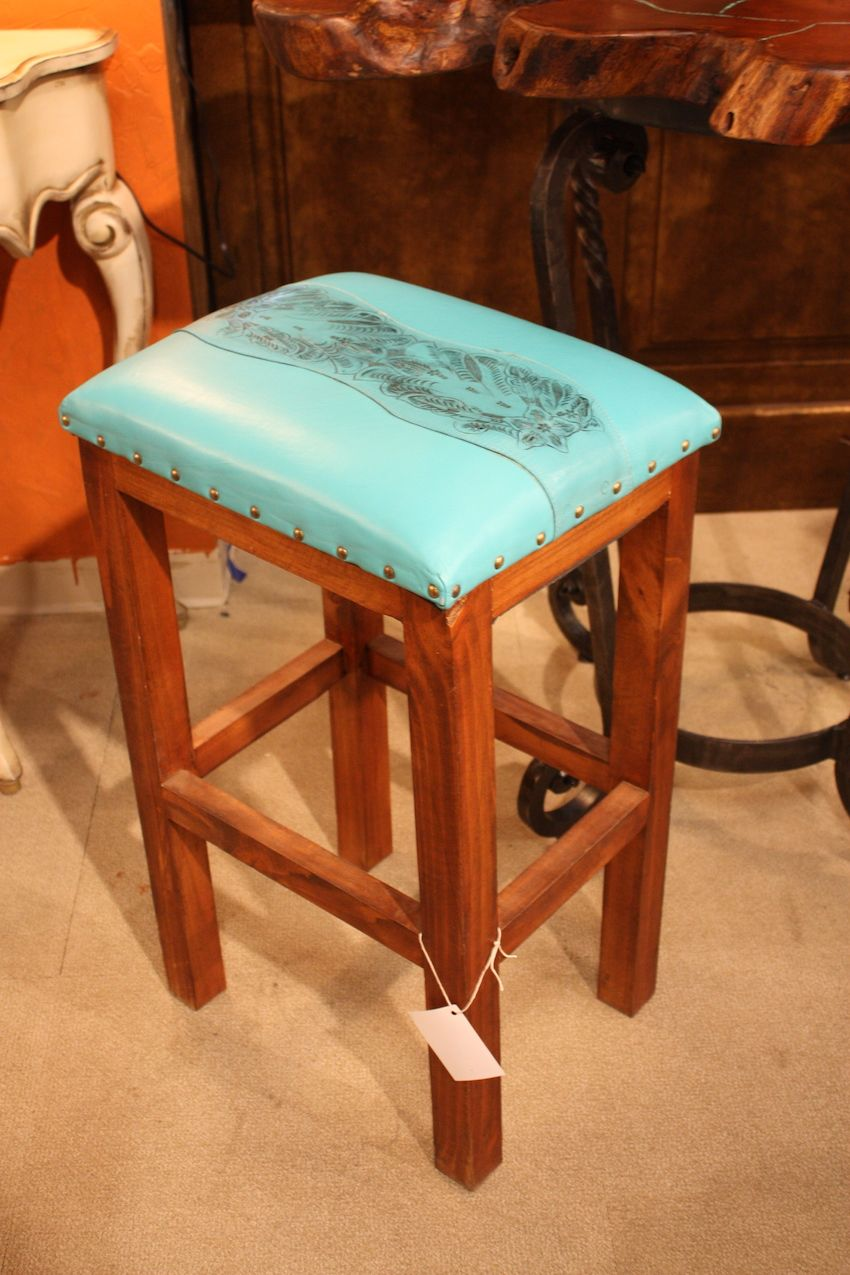 Small leather pieces like this barstool from Bell Rustica add flair to a room.