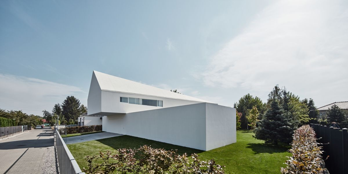 The side of the house facing the street was designed to offer as much privacy as possible and has no windows or openings