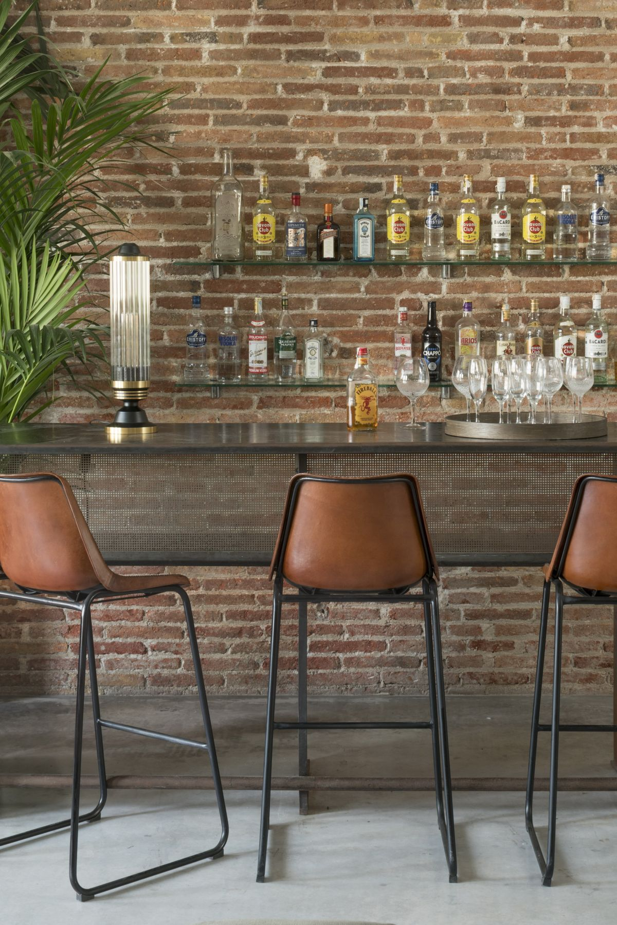 The new design preserves a lot of the original features of the apartment including the brick walls