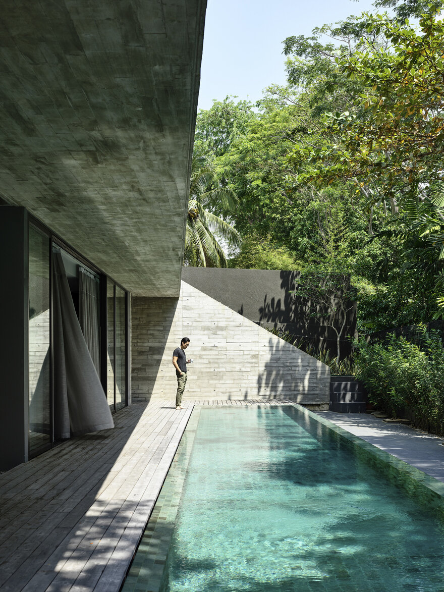 1569879310 125 a stylish glass and concrete house shielded by lush greenery - A Stylish Glass And Concrete House Shielded By Lush Greenery