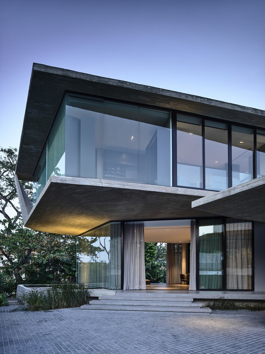 1569879310 135 a stylish glass and concrete house shielded by lush greenery - A Stylish Glass And Concrete House Shielded By Lush Greenery