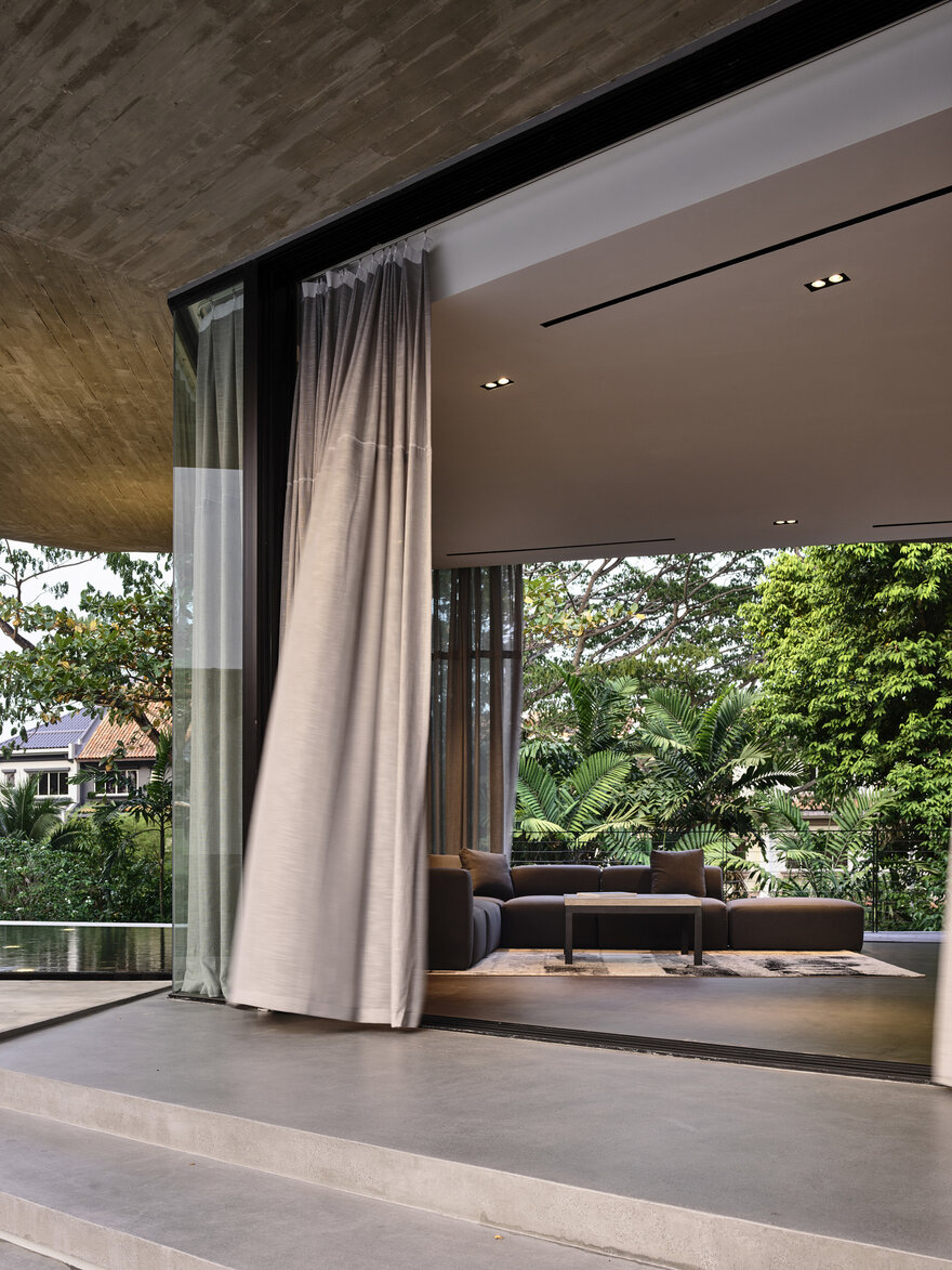 1569879310 552 a stylish glass and concrete house shielded by lush greenery - A Stylish Glass And Concrete House Shielded By Lush Greenery