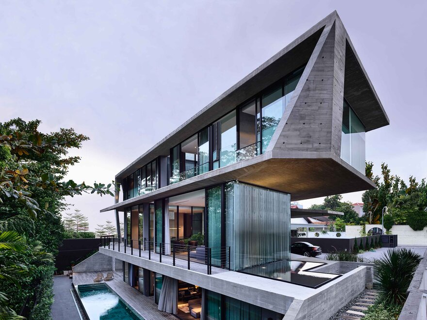 1569879310 95 a stylish glass and concrete house shielded by lush greenery - A Stylish Glass And Concrete House Shielded By Lush Greenery