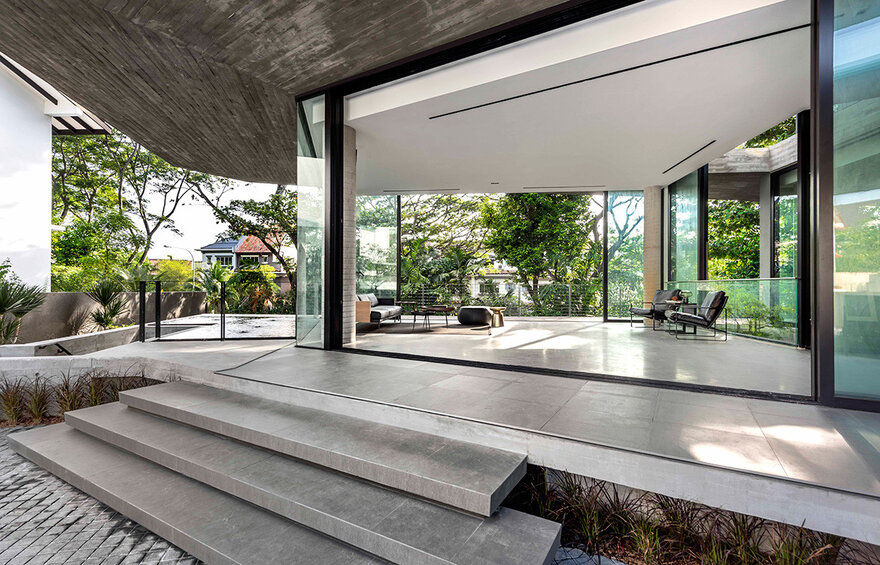 1569879310 979 a stylish glass and concrete house shielded by lush greenery - A Stylish Glass And Concrete House Shielded By Lush Greenery
