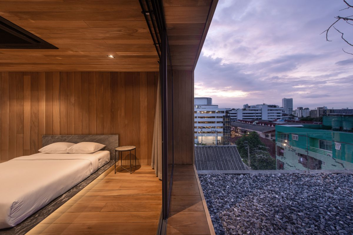 1569913485 620 a charming wooden house sits on the rooftop of an apartment building - A Charming Wooden House Sits On The Rooftop Of An Apartment Building