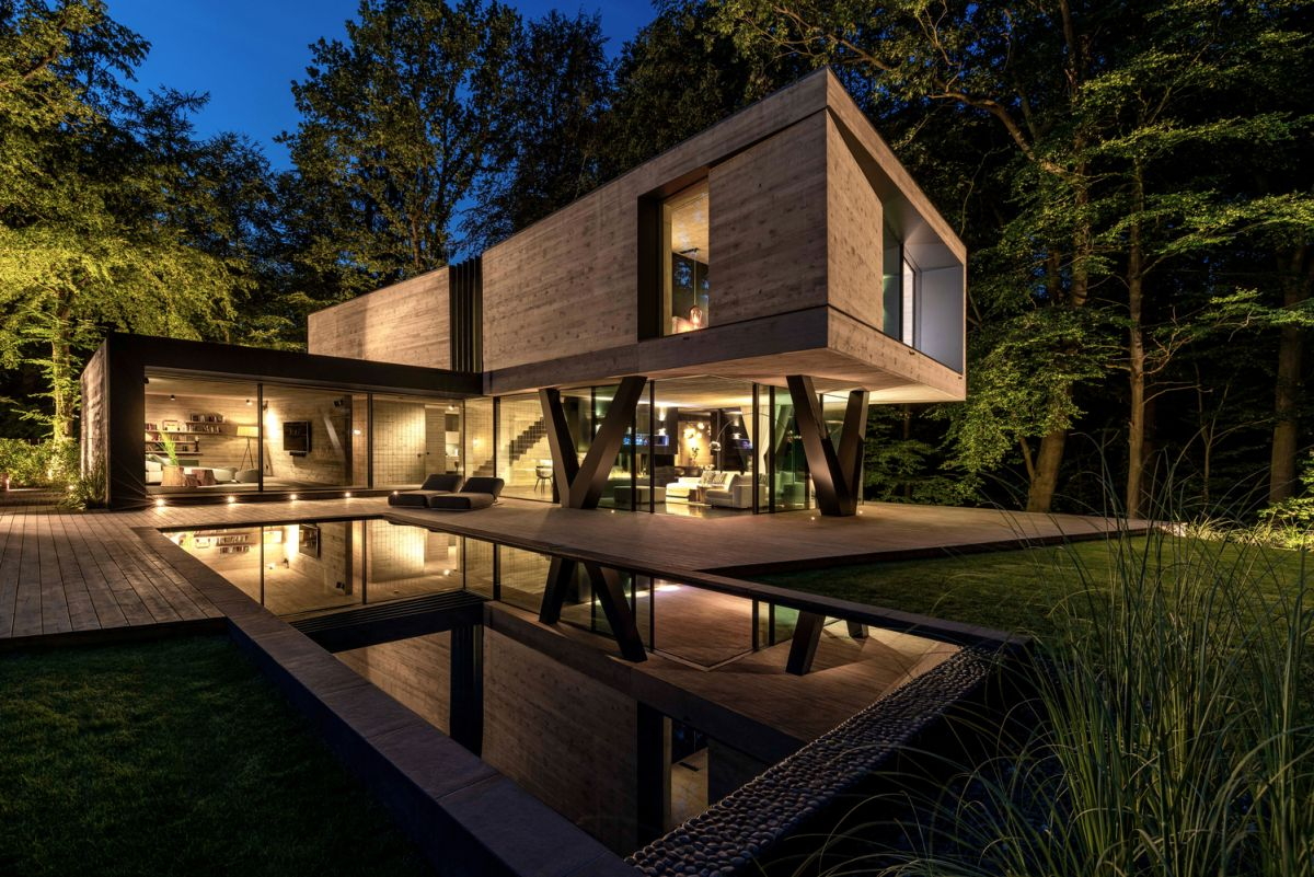 The living areas form an L-shaped floor plan which shelters an intimate outdoor terrace