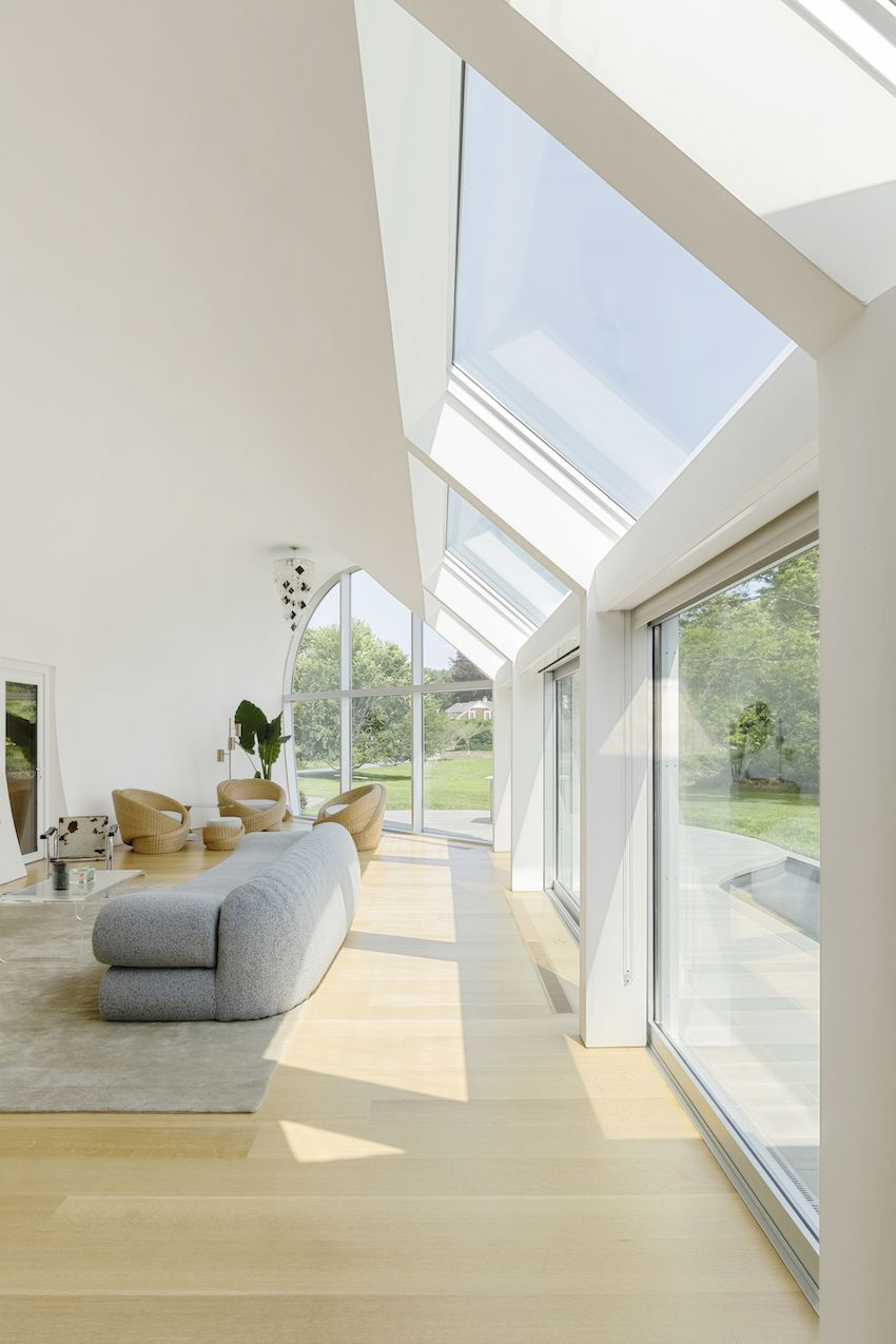 1571399380 224 long islands cocoon house hides lots of glass and boldly hued skylights - Long Island's Cocoon House Hides Lots of Glass and Boldly Hued Skylights
