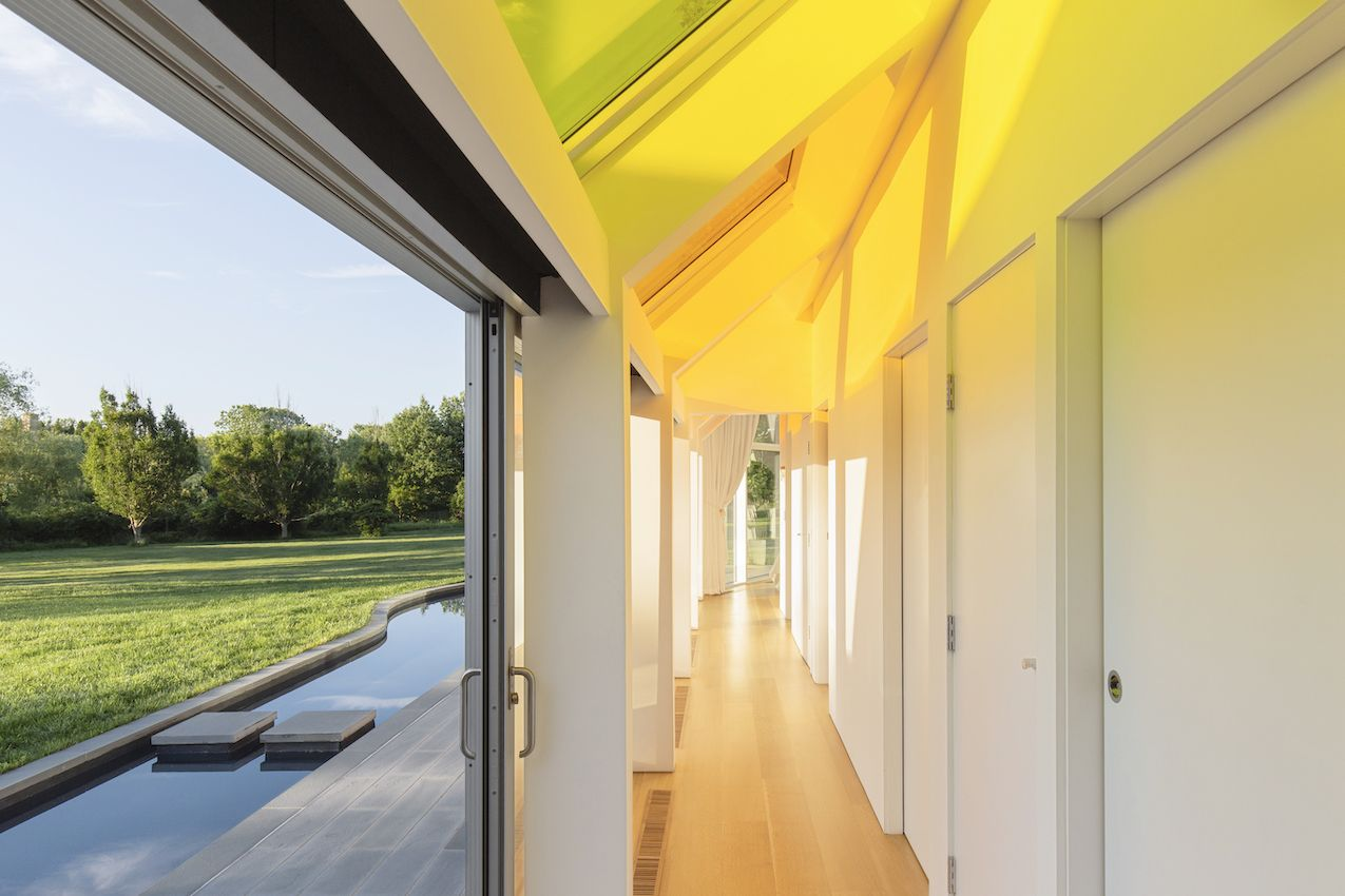 1571399381 870 long islands cocoon house hides lots of glass and boldly hued skylights - Long Island's Cocoon House Hides Lots of Glass and Boldly Hued Skylights