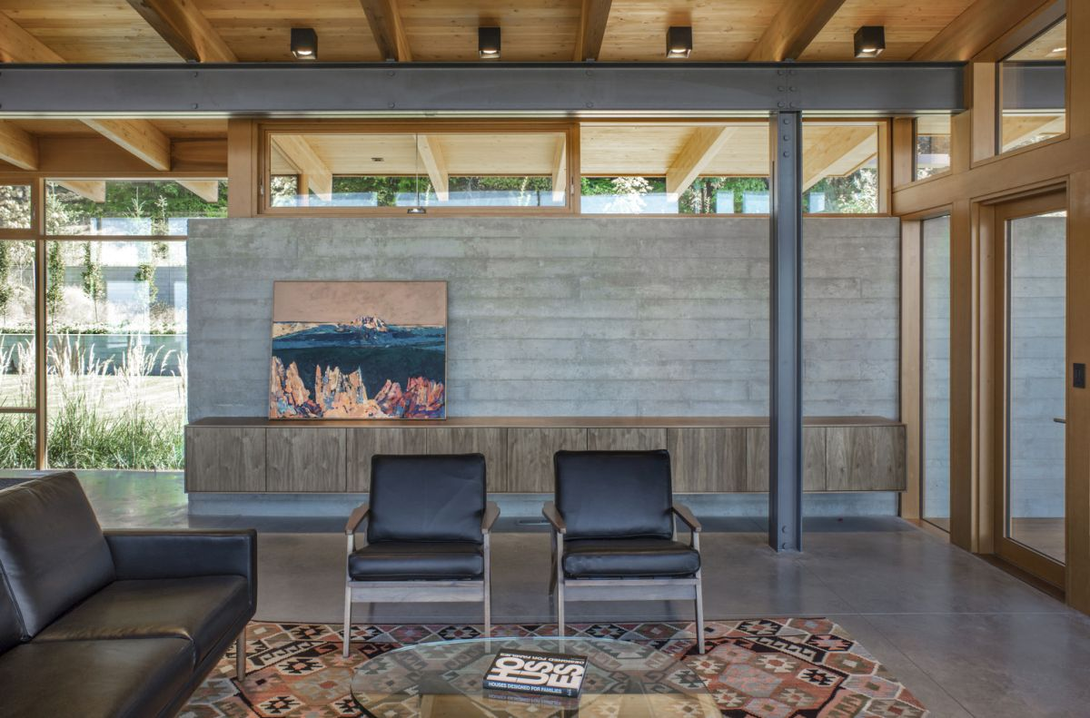 The concrete wall is not an external addition but an actual integral part of the house