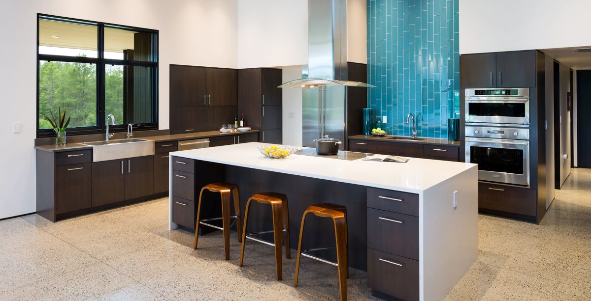 The kitchen is spacious and open and features eye-catching turquoise accents