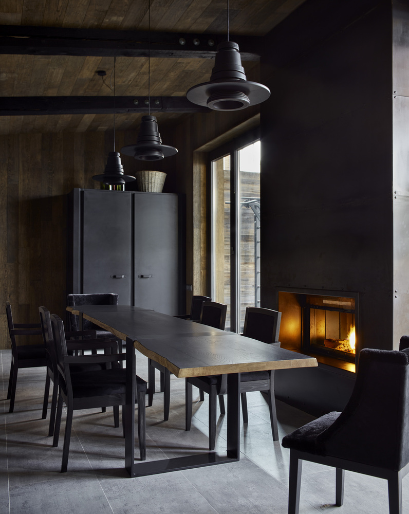 There's a dining area placed right next to the fireplace which also gets a view towards the courtyard