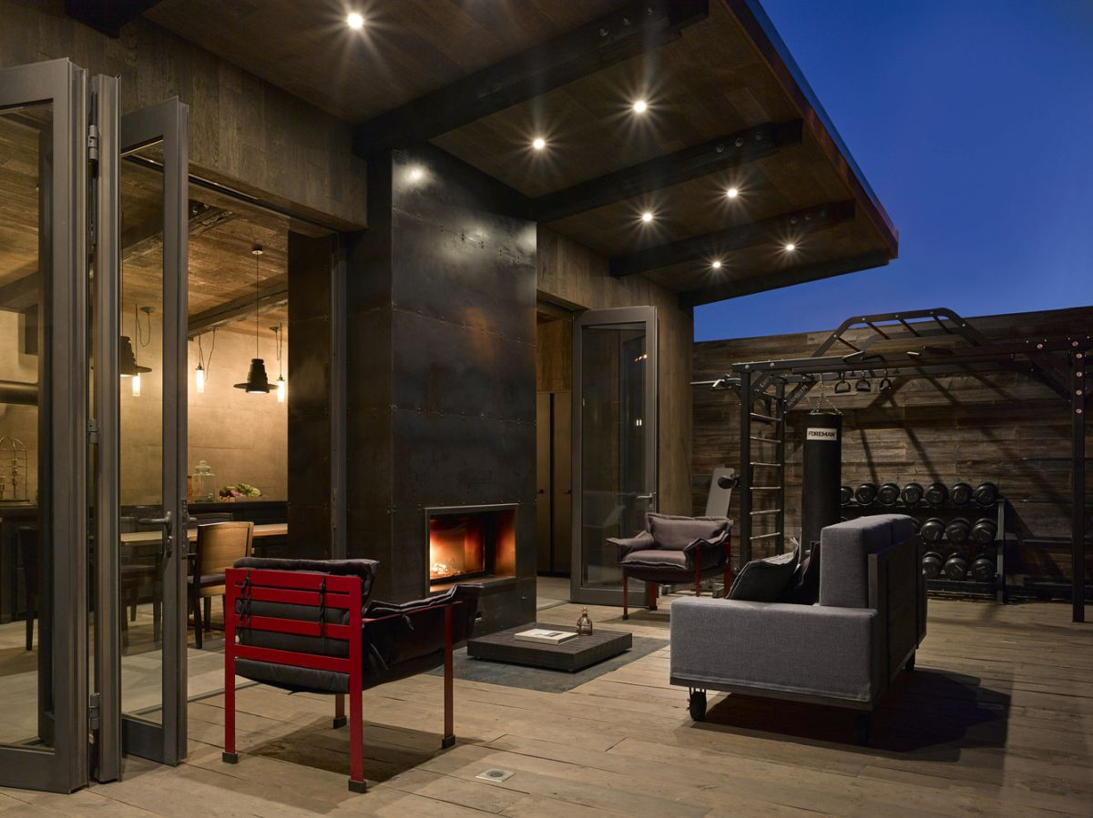 Outside, the kitchen extends into a terrace situated between it and the main house