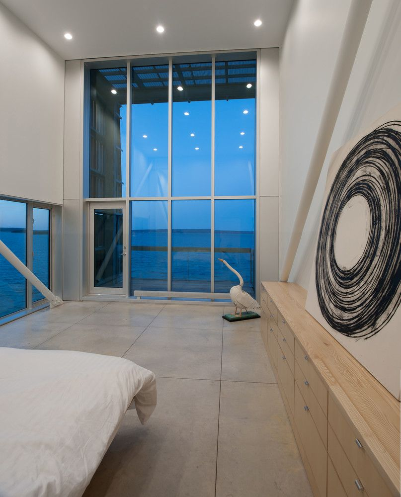 The master bedroom opens onto a covered terrace with a direct view towards the sea