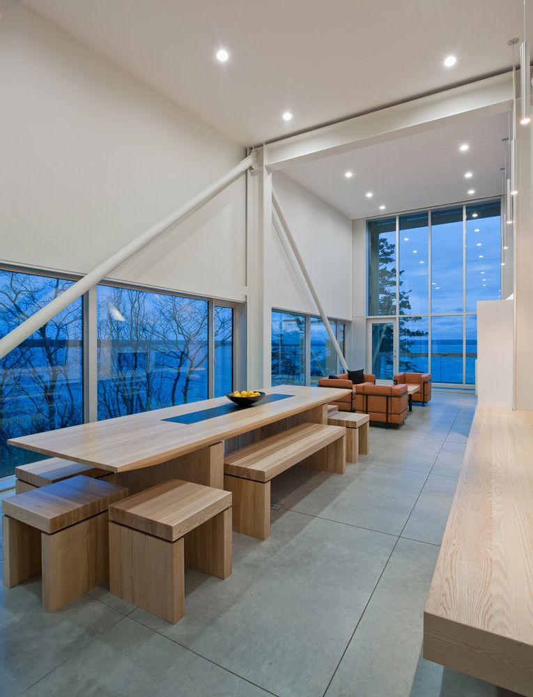 Inside, large windows expose the spaces to the gorgeous views and bring in lots of natural light