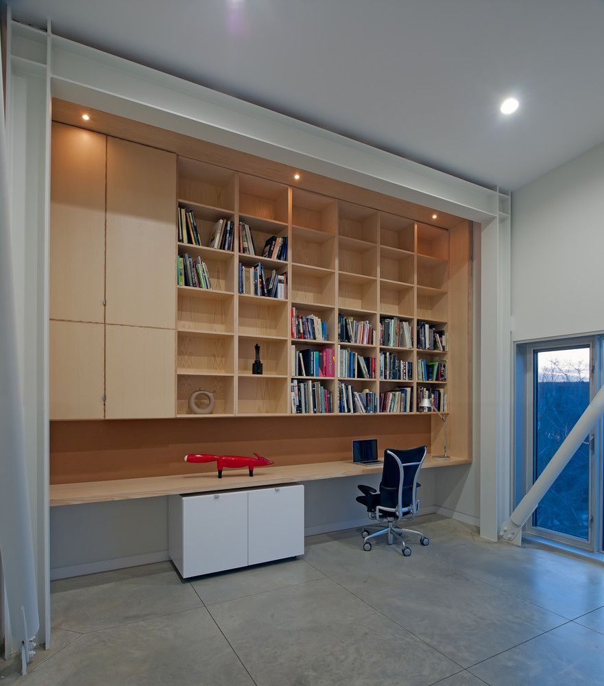 The home office has a minimalistic design just like the rest of the house and is all concentrated on one wall