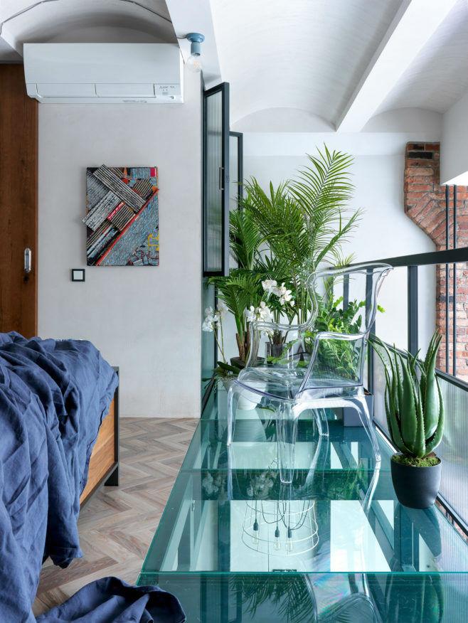 loft bedroom with glass flooring