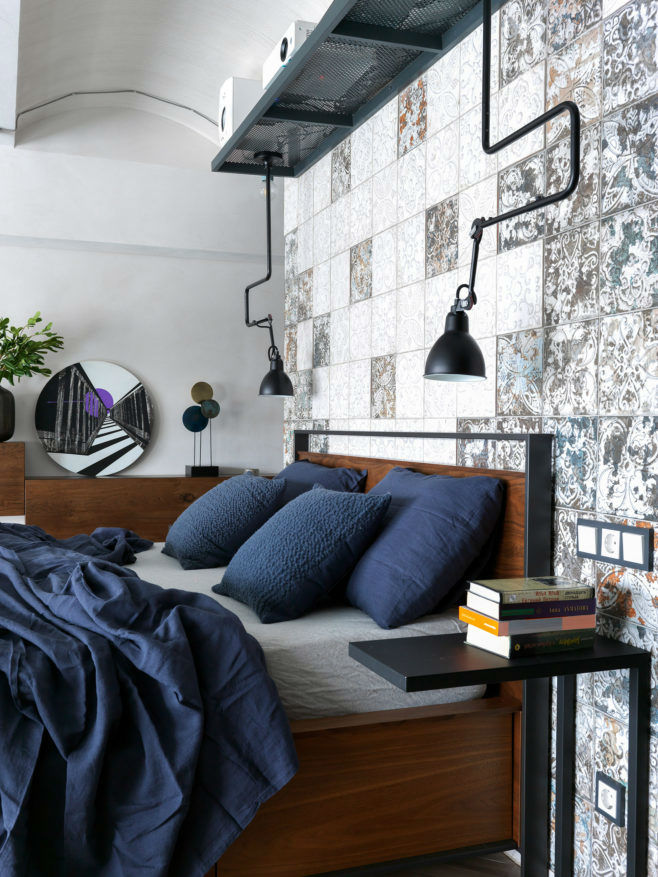 industrial style loft bedroom with navy blue sheets