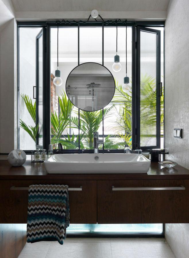 bathroom with large window above the bathroom sink