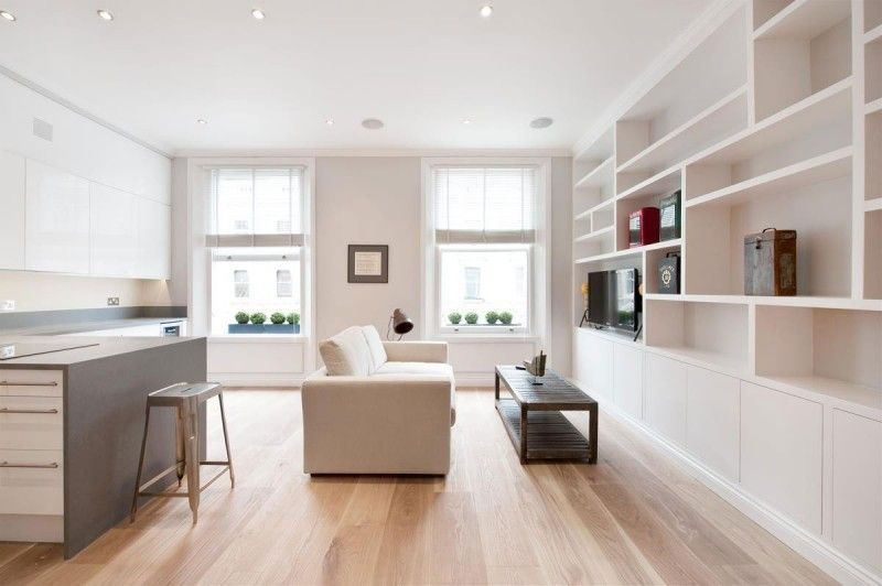 In this case, Ardesia Design used white and off-white furniture to create a bright and inviting living room