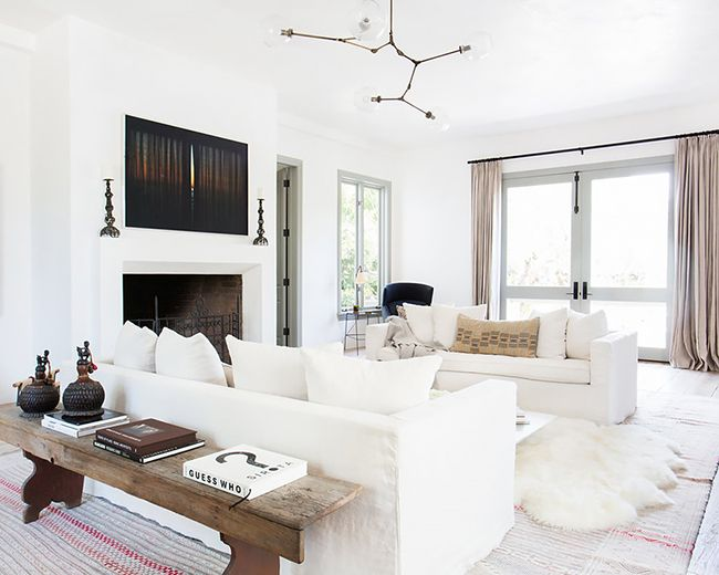 This is a living room designed by Vanessa Alexander and features a modern decor with Tuscan influences