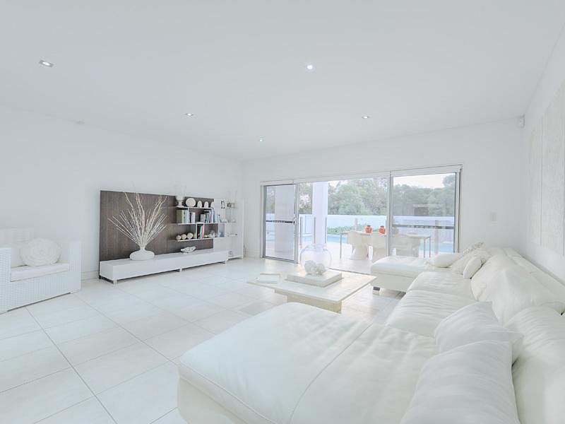 An all-white living room can end up looking cold and austere without a suitable palette of textures and finishes