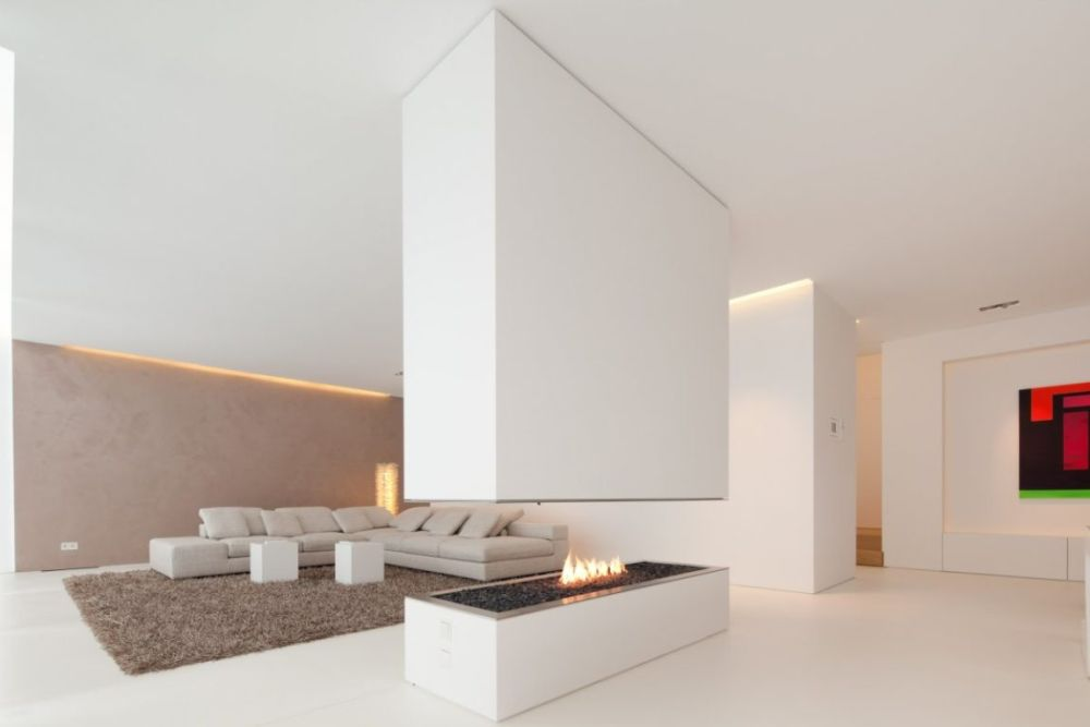 Complement a white sofa with a colored rug or an accent wall for a balanced look